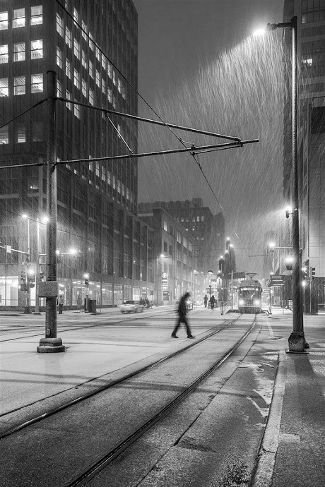 3Man-walking-across-street-in-snowstorm,-Minneapolis,-Minnesota,-USA IanPlant